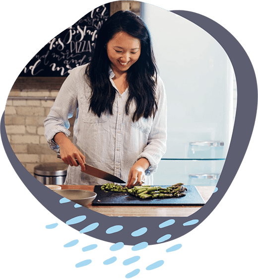 a food blogger cooking in the kitchen